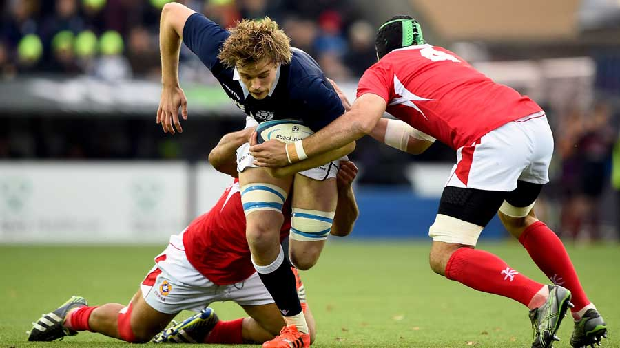 Scotland lock Jonny Gray tries to get through the Tonga defence