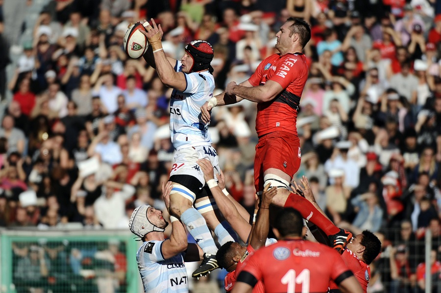 Wenceslas Lauret of Racing Metro does battle with Toulon's Ali Williams at the lineout