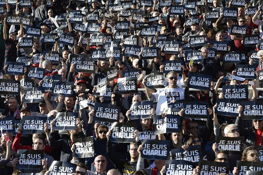 Fans at the Stade Félix-Mayol pay tribute to those who lost their lives in the Charlie Hebdo disaster