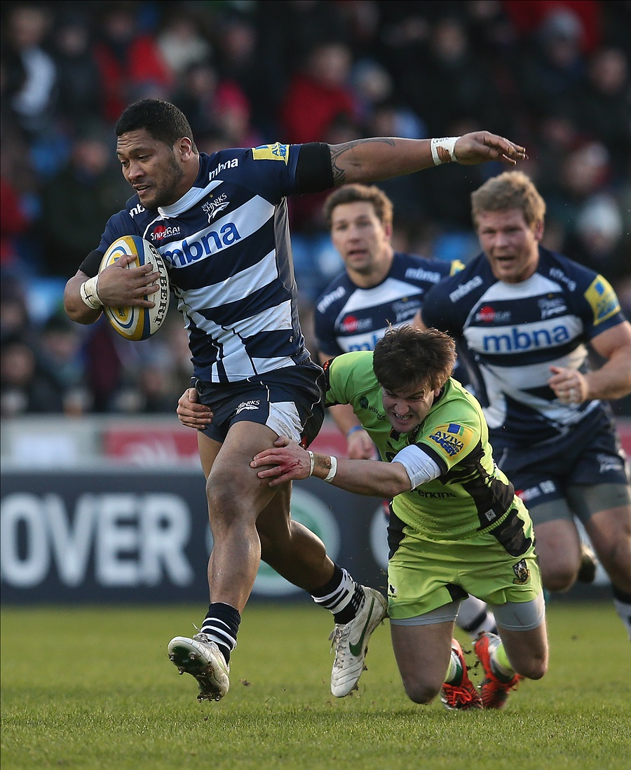 Sale's Johnny Leota attempts to escape the clutches of Northampton's Lee Dickson
