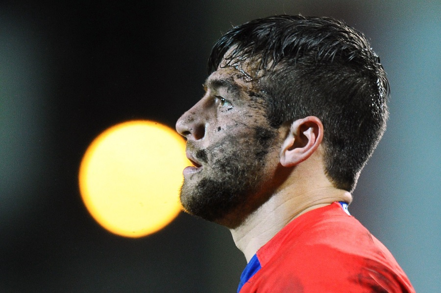 Grenoble's Julien Caminati finds the game is messy work