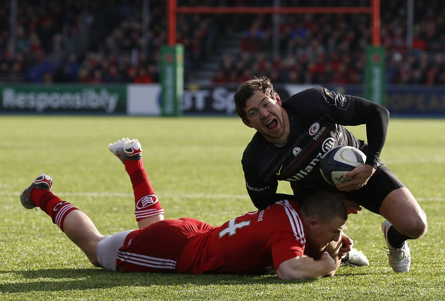 Alex Goode is tackled by Munster's Andrew Conway