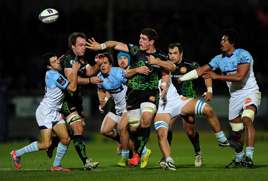 Exeter's Dave Ewers offloads amid a sea of bodies
