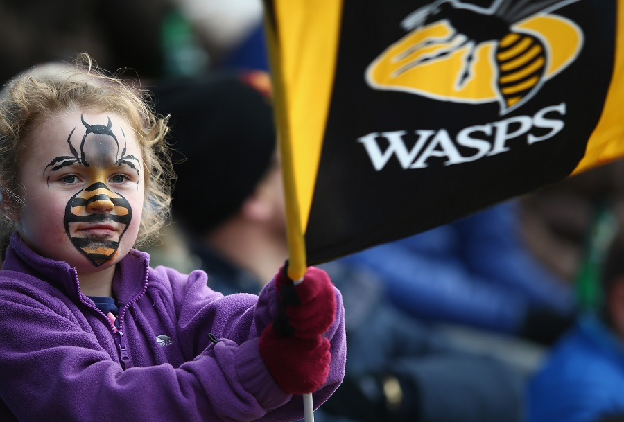 A young Wasps fan cheers her team on at the Ricoh Arena