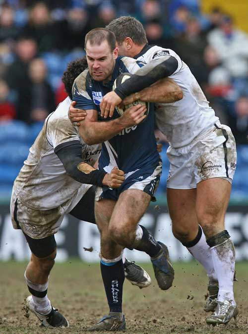 Sale's Charlie Hodgson is tackled by Newcastle's Tom May