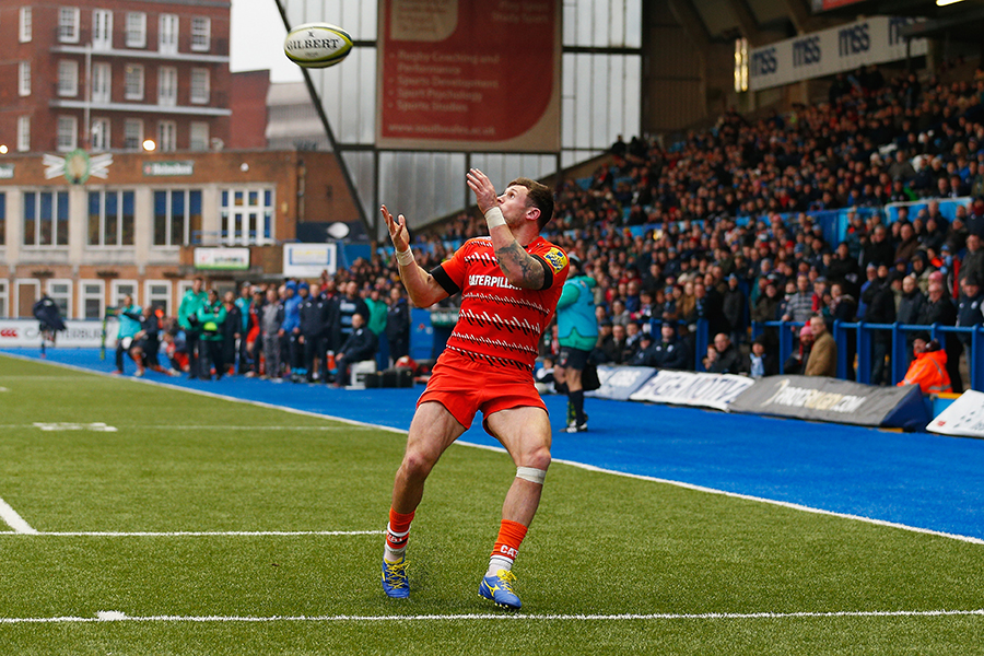 Adam Thompstone catches a cross-field kick from team-mate George Catchpole to score a try