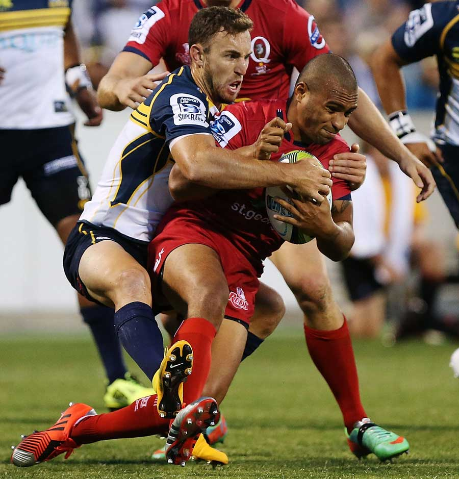 Reds scrum-half Will Genia is brought down