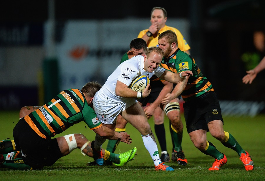 Alex Waller and Mike Haywood of Northampton Saints tackle London Irish's Shane Geraghty