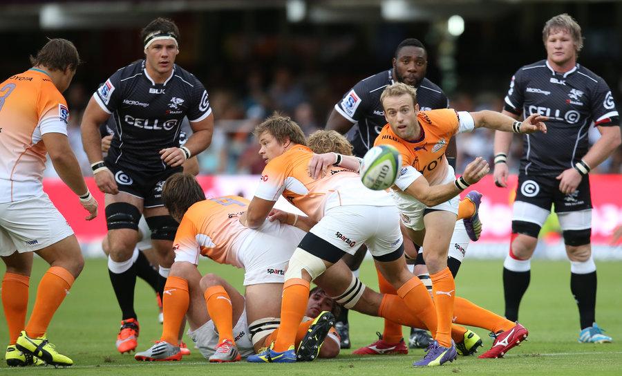 Cheetahs' half-back Sarel Pretorius passes the ball from behind the ruck