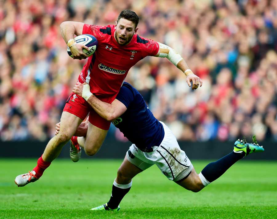 Wales' Alex Cuthbert tries to break through the Scotland defence