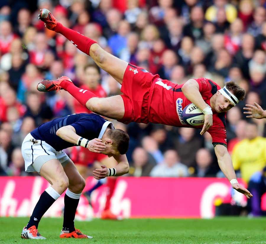 Scotland's Finn Russell catches Dan Biggar in the air