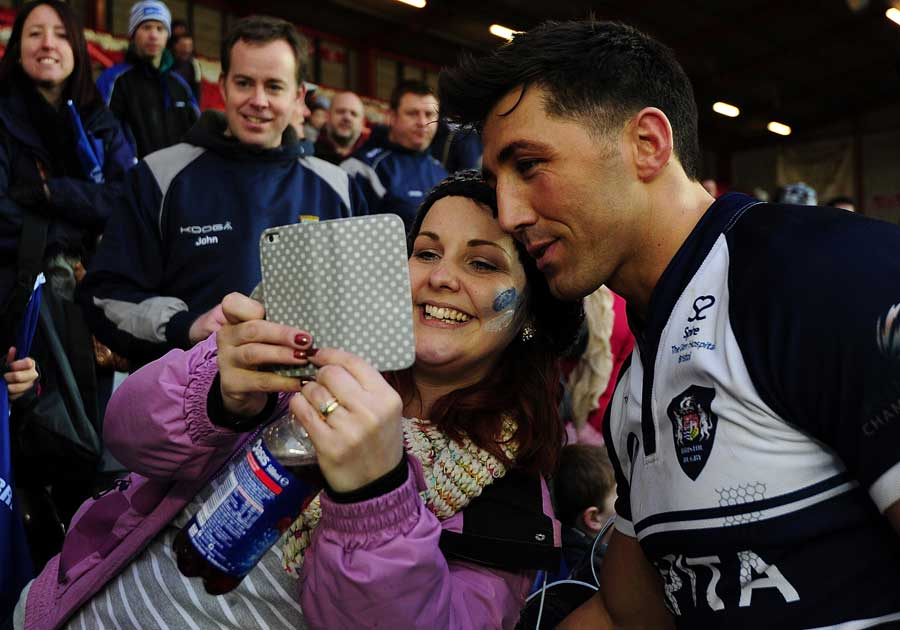 Gavin Henson poses for a photo with a fan after making his Bristol debut