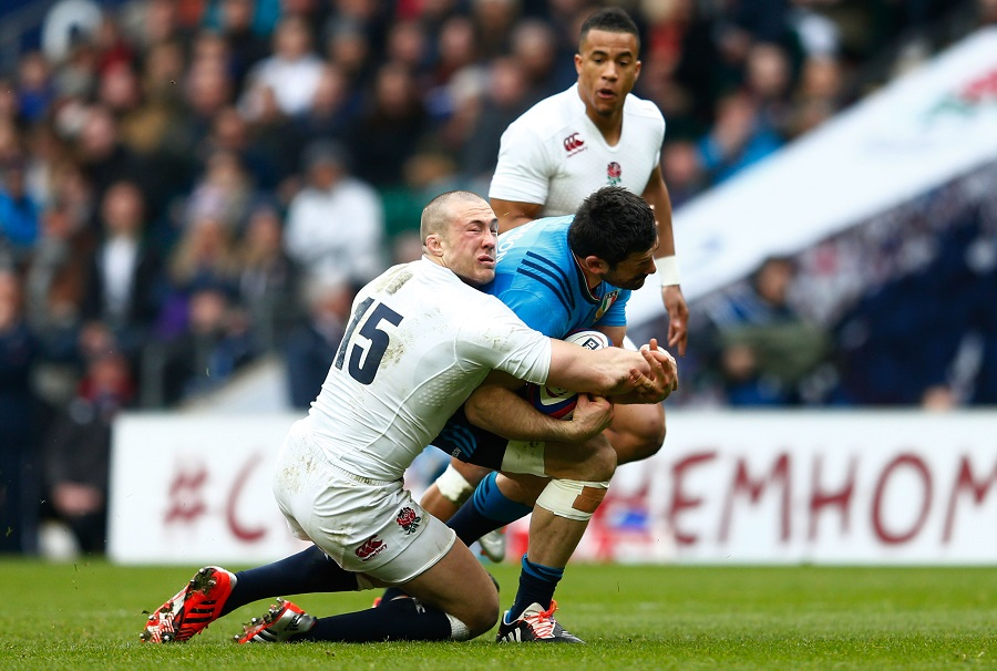 England fullback Mike Brown clashes with Italy's Andrea Masi