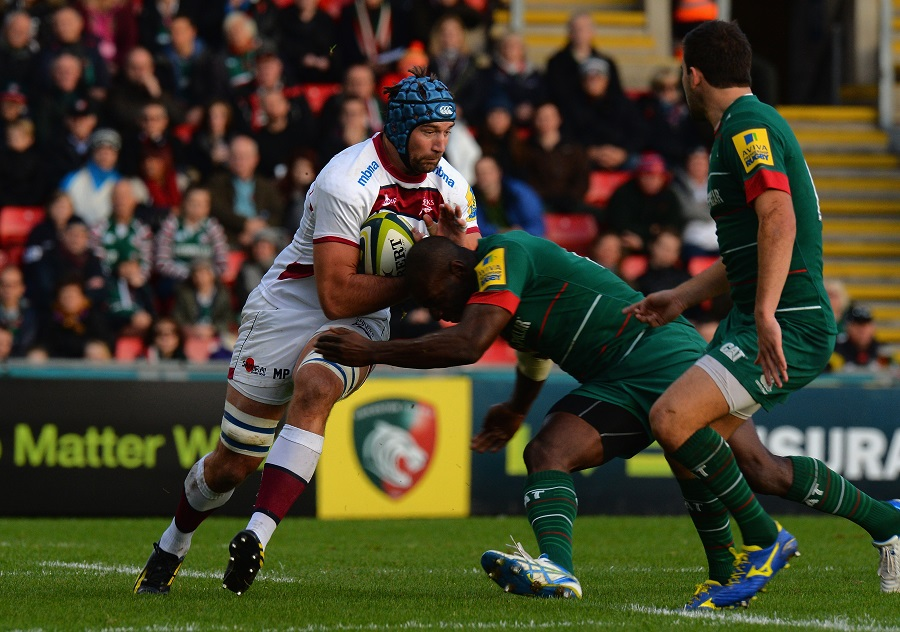 Sale's Michael Paterson takes on Leicester tackler Miles Benjamin