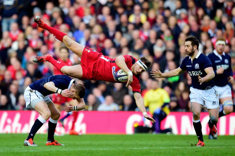 Dan Biggar is caught by Scotland's Finn Russell