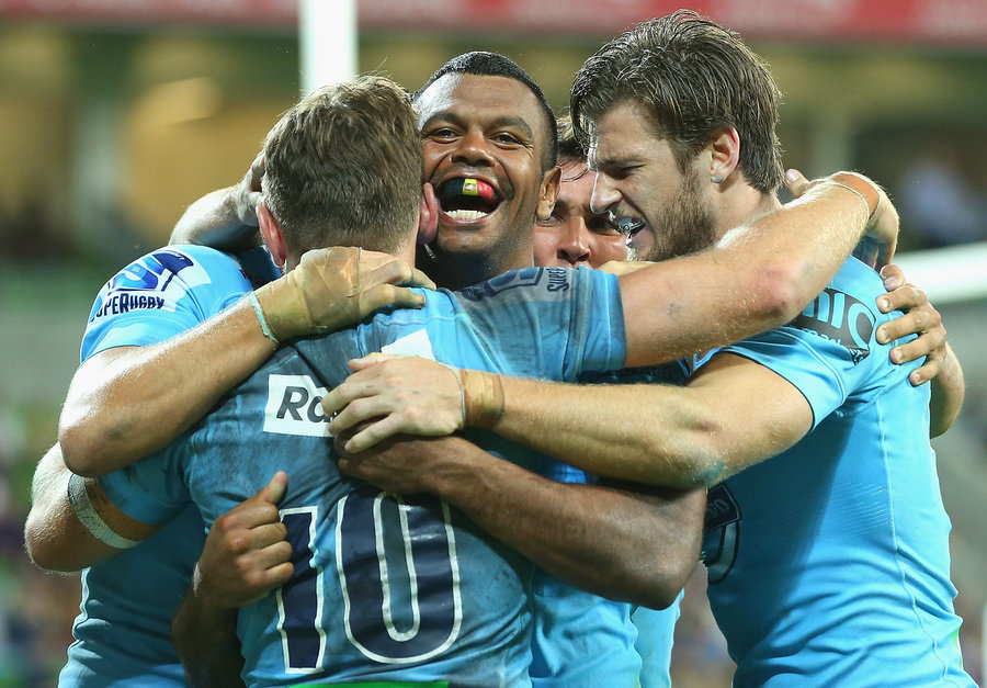 Kurtley Beale celebrates a try with Bernard Foley and Rob Horne
