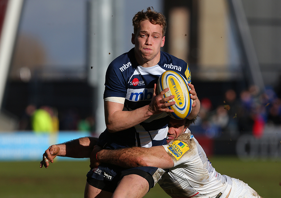 Mike Haley is tackled by David Strettle