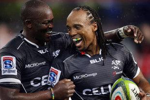 The Sharks' Lubabalo Mtembu (L) and Odwa Ndungane enjoy a moment, Sharks v Lions, Durban, February 21, 2015