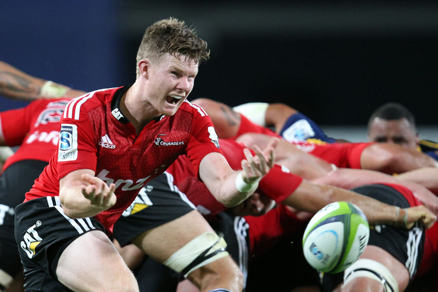 The Crusaders' Mitchell Drummond passes the ball from a scrum