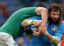 Italy's Martin Castrogiovanni rides a tackle