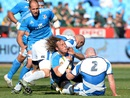 Josh Furno is tackled by Scotland defenders