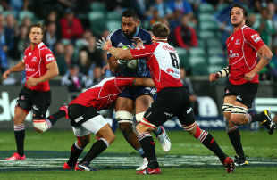 Patrick Tuipuluotu of The Blues takes on the Lions defence, Blues v Lions, Super Rugby, North Harbour Stadium, Auckland, March 7, 2015