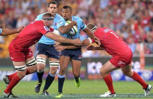 The Waratahs' Kurtley Beale takes on the Reds' defence, Queensland Reds, Waratahs, Super Rugby, Suncorp Stadium, Brisbane, March 7, 2015