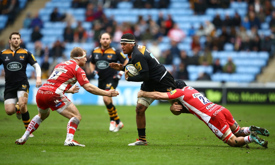 Nathan Hughes is tackled by Gloucester defenders