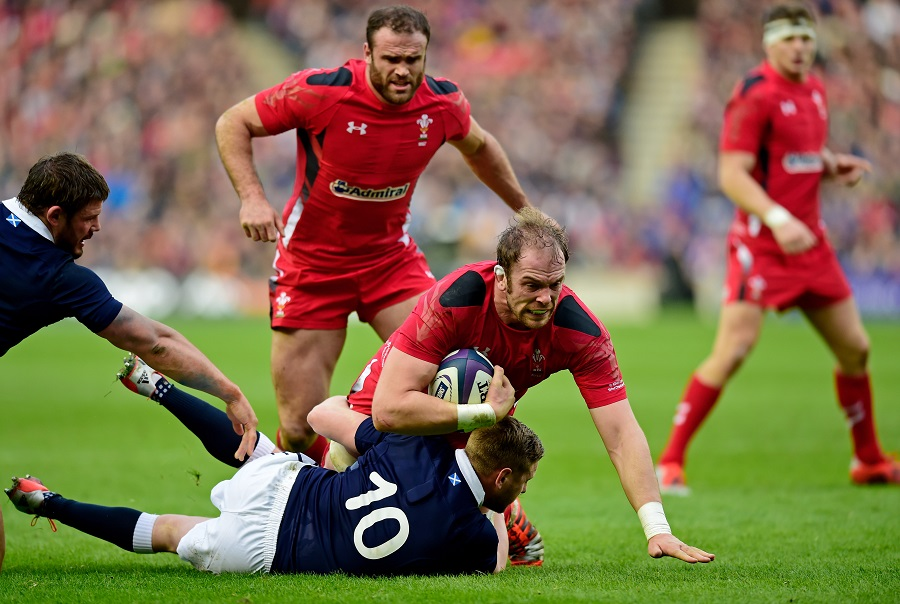 Alun Wyn Jones is brought down by Finn Russell