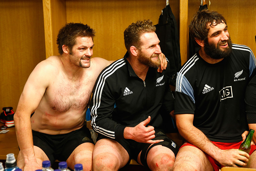 Richie McCaw, Kieran Read and Sam Whitelock of the All Blacks in the dressing room following their win over Wales