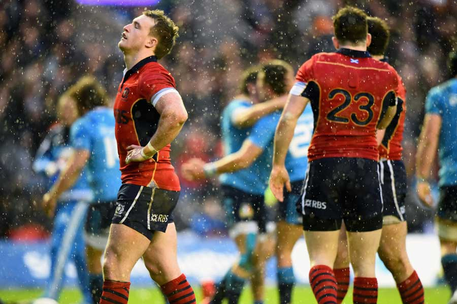 Scotland's Stuart Hogg reacts to their loss to Italy