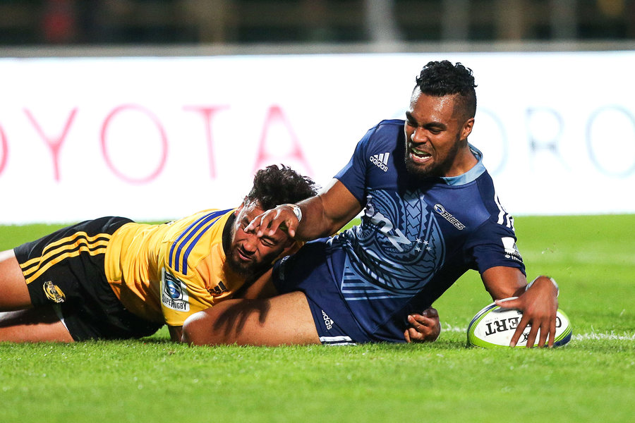 Lolagi Visinia of the Blues crashes over to score a try