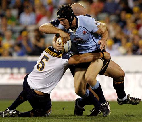 Waratahs fullback Sam Norton-Knight is tackled by the Brumbies' defence