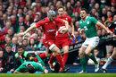 Jonathan Davies delivers a hand-off on Jonathan Sexton