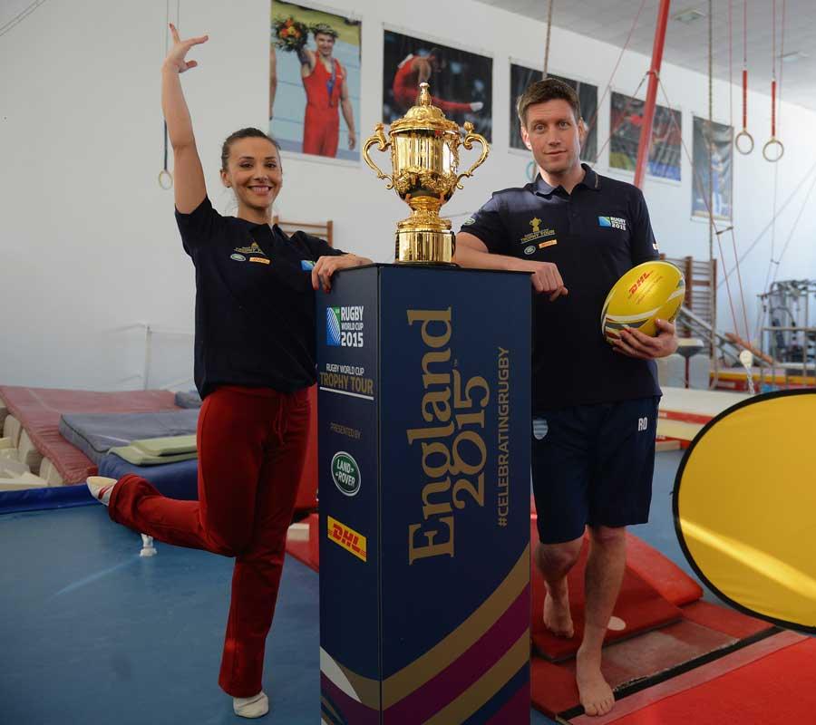 Gymnast Andreea Raducan poses alongside the Rugby World Cup with Ronan O'Gara