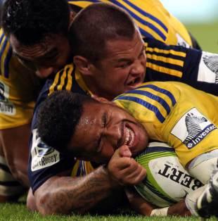 Hurricanes' Ardie Savea is floored, Highlanders v Hurricanes, Super Rugby, Forsyth Barr Stadium, Dunedin, March 20, 2015