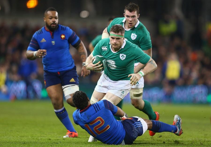 Jamie Heaslip is tackled by Wesley Fofana