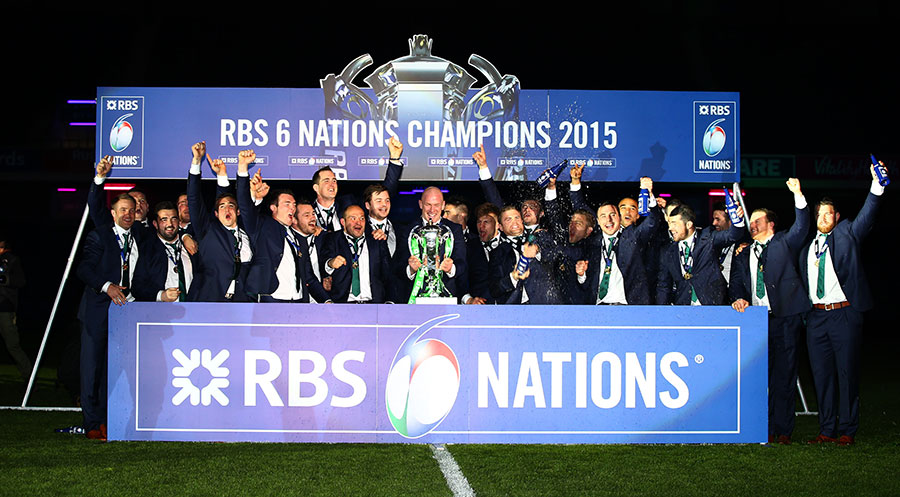Paul O'Connell is presented with the new Six Nations trophy as the Ireland team celebrates
