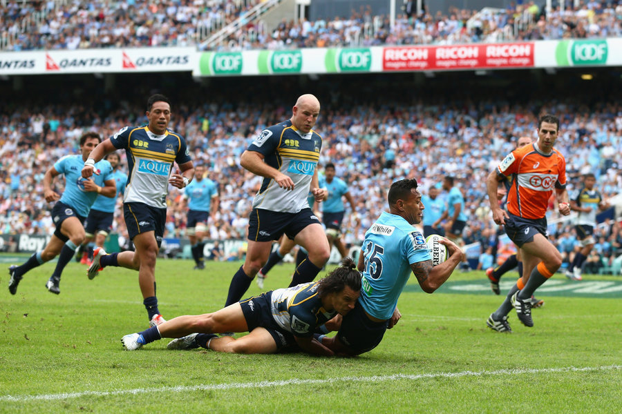 Israel Folau of the Waratahs scores a try