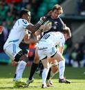 Saracens' Marcelo Bosch is wrapped up by Exeter