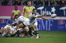 Stade Francais' scrum-half Julien Tomas fires off a pass
