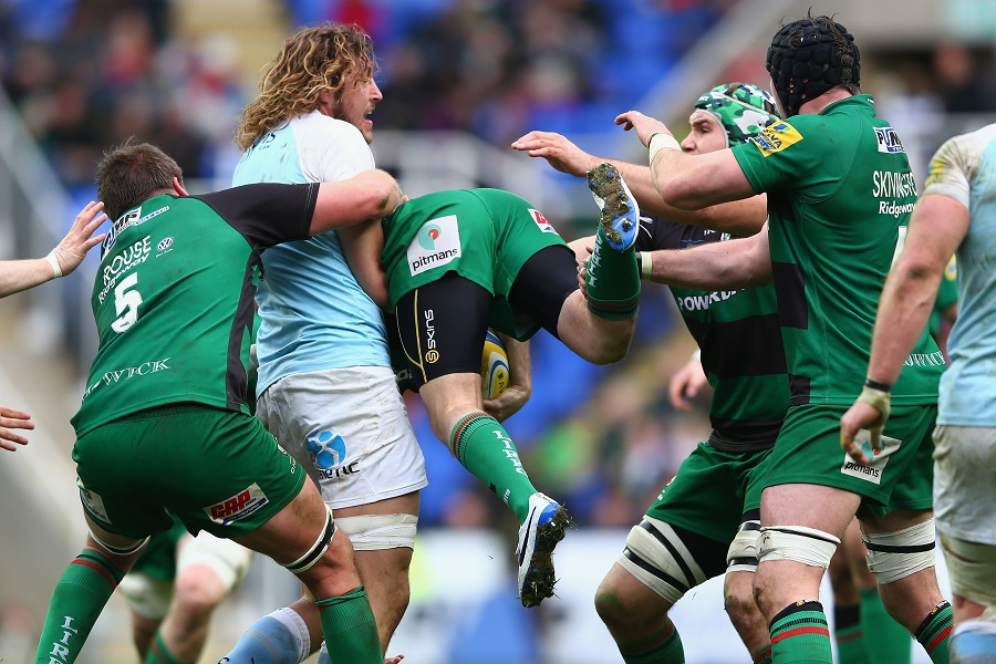 Josh Furno of Newcastle Falcons upends London Irish's Chris Noakes in an offence leading to a yellow card