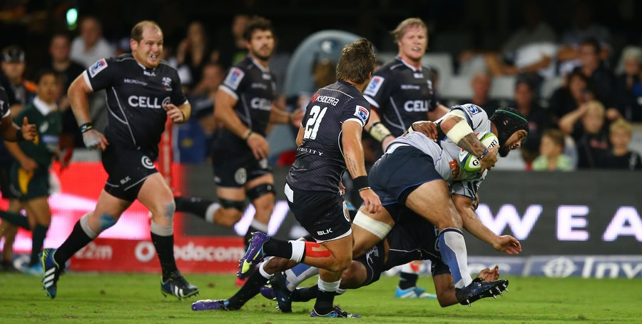Tetera Faulkner of the Western Force charges into the Sharks defence