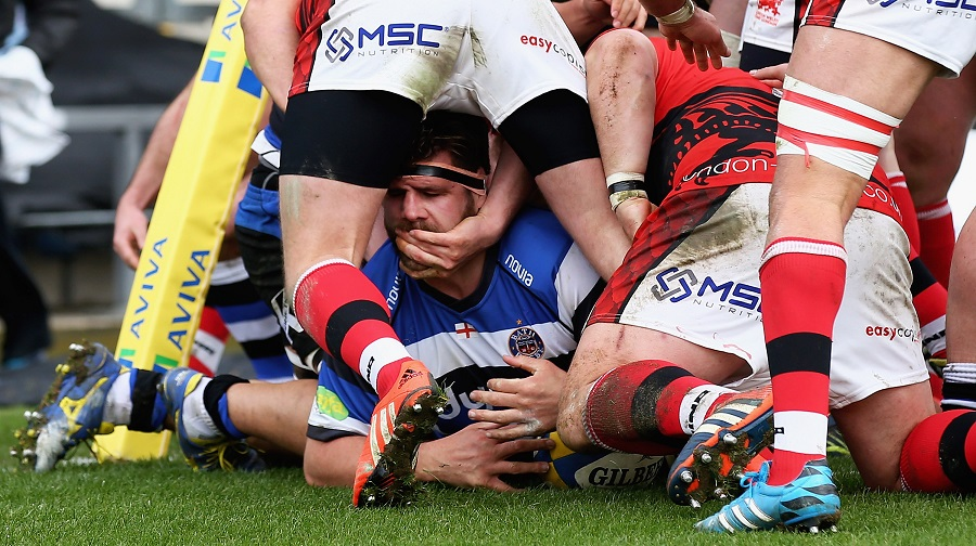 Rob Webber of Bath scores a try