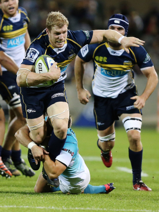 The Brumbies' David Pocock breaks a tackle, Brumbies v Cheetahs, Super Rugby GIO Stadium, Canberra, April 4, 2015