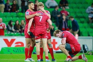 The Reds' Liam Gill is consoled by team-mates, Rebels v Reds, Melbourne, April 3, 2015