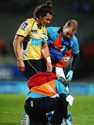 The Brumbies' Matt Toomua is forced from the field, Blues v Brumbies, Auckland, April 10, 2015