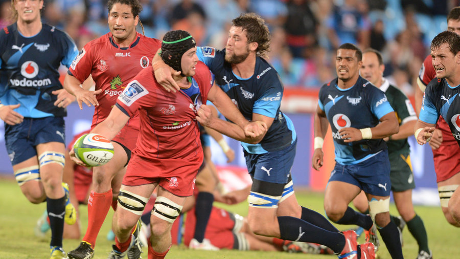 Liam Gill of the Queensland Reds is taken down by the Bulls' defence, Bulls v Reds, Super Rugby, Loftus Versfeld, Pretoria, April 11, 2015