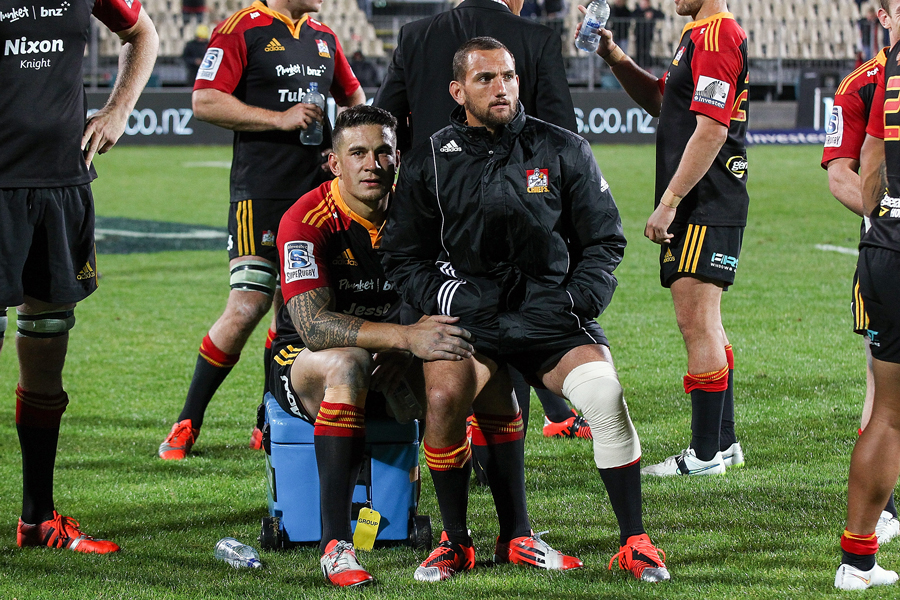 The Chiefs' Sonny Bill Williams and Aaron Cruden sit on the sidelines