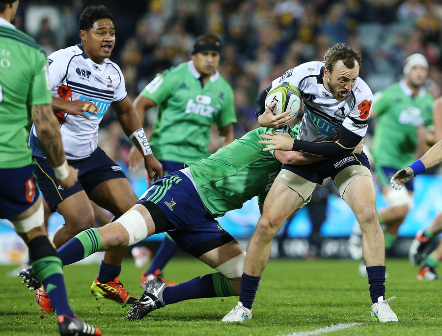 Jesse Mogg of the Brumbies takes on the Highlanders defence